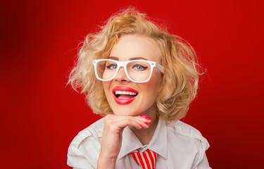 Smiling woman  wearing eyeglasses and looking you