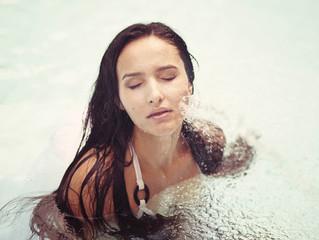brunette girl in pool water