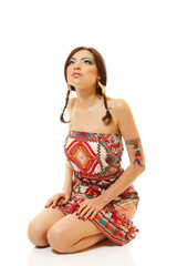 Beautiful young woman native Maya American Indian dressed in nat