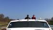 Men driving the boat, closeup