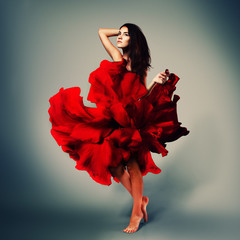 beautiful romantic girl in red flower dress with long broun hair