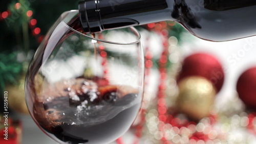 Pouring Wine Into Glass and christmas tree