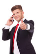 business man on phone thumb up
