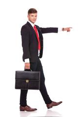 business man walking & pointing