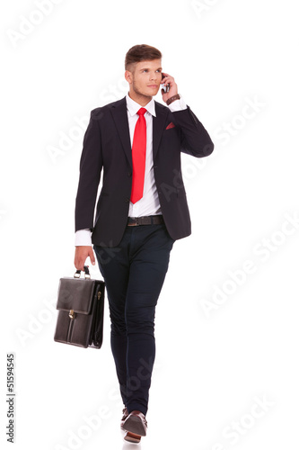 business man on phone walks