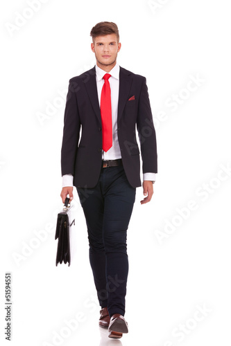 business man walks with briefcase
