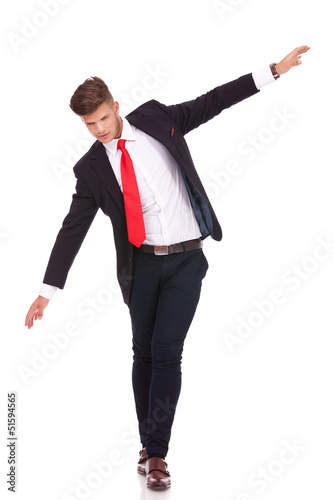 business man balancing