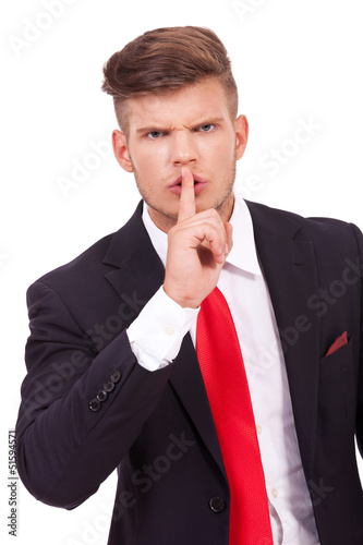 business man silencing you