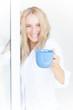 Cute female with blue tea mug