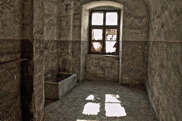 old concrete cell with toilet