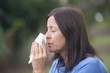 Woman suffering flu or hayfever outdoor