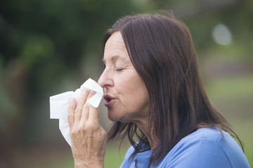 Woman with tissue suffering flu or hayfever