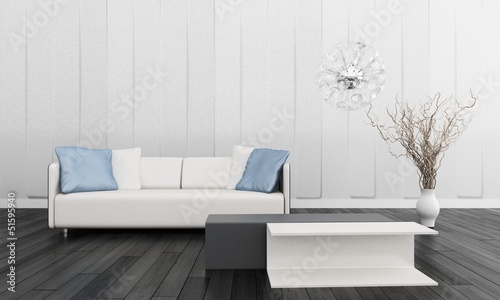 Modern White Couch with Blue Pillows in Front of Wall