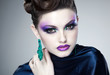 professional blue make-up and hairstyle on beautiful woman face