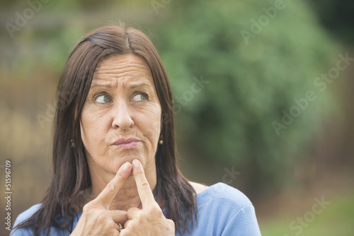 Portrait thoughtful woman outdoor background