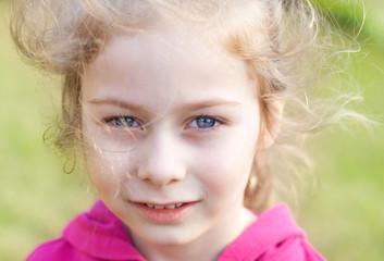 Five years old caucasian blond child girl - outdoor