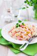Pasta in cream sauce with crawfish, selective focus