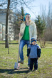 woman and boy  with spade  in park