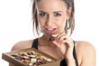 Model Released. Woman Eating Chocolates