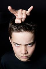 Teufelchen - Junge mit bösem Blick und Teufel Hörner
