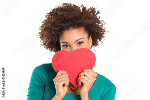 Young Girl Holding a Paper Heart in Hand