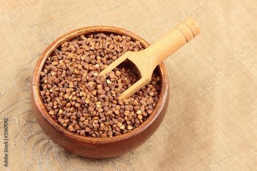 buckwheat in wooden bowl - 51601142