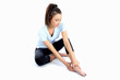 Model Released. Woman With Ankle Sports Injury