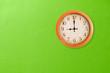 Leinwanddruck Bild - Clock showing 9 o'clock on a green wall