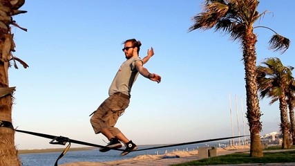 Two jumps on a slackline