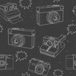 Black and white pattern with photo cameras.