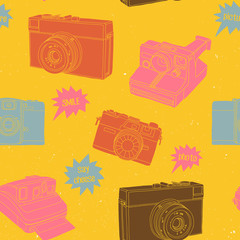 Bright seamless pattern with photo cameras.