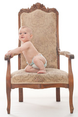 Little boy sits on the retro chair