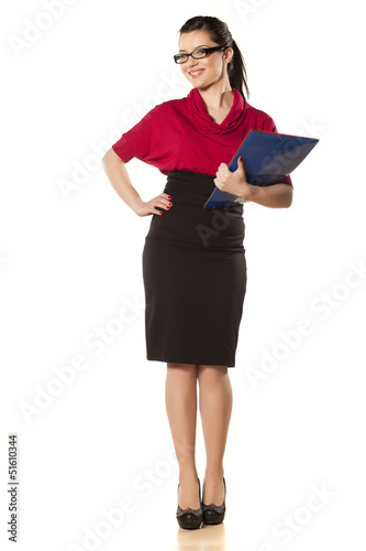 pretty girl with folder in her hand posing on white background
