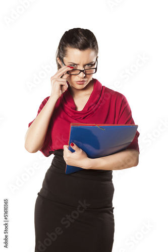 girl with a folder in her hands posing on white background