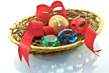 Egg, heart,emeralds, love is in the basket on a white .