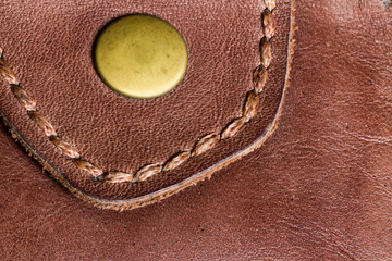 Texture of brown leather purse in high definition