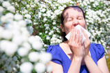 Allergic woman sneezing in handkerchief poster