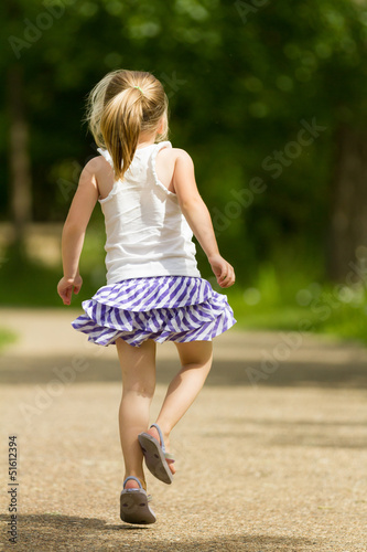 Young girl skipping away