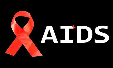 Aids awareness red ribbon isolated on black