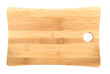Wooden cutting board over white background