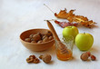 Autumn Still Life with honey, apples and nuts on old table