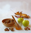 Autumn Still Life with honey, green apples and nuts on old table