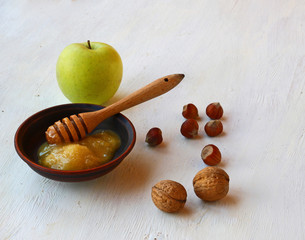 Autumn Still Life with honey, green apple and nuts