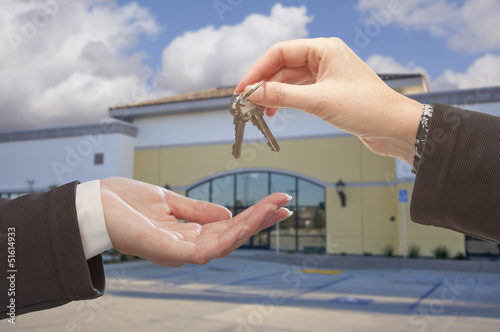 canvas print picture Agent Handing Over the Keys in Front of Business Office