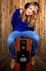 the girl sitting on the speaker