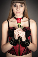 beautiful woman in handcuffs with a rose in hand