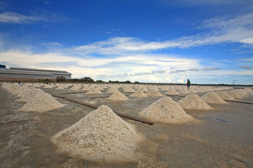 Pile of salt on farm against blue sky