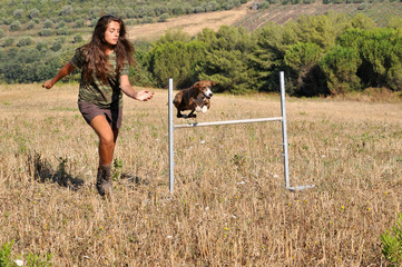Dog  agility instructor  in the countryside