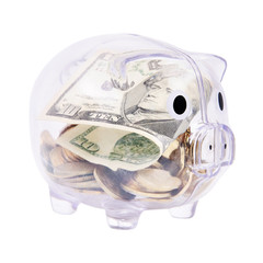 Savings in piggy bank isolated on white background