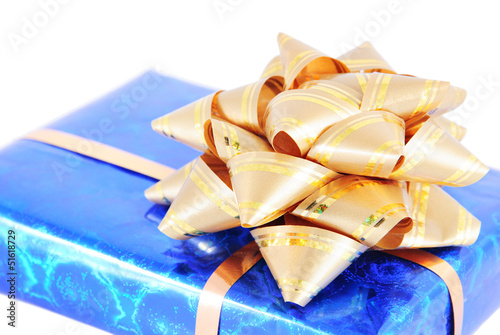 blue box with gift  golden bow isolated on white